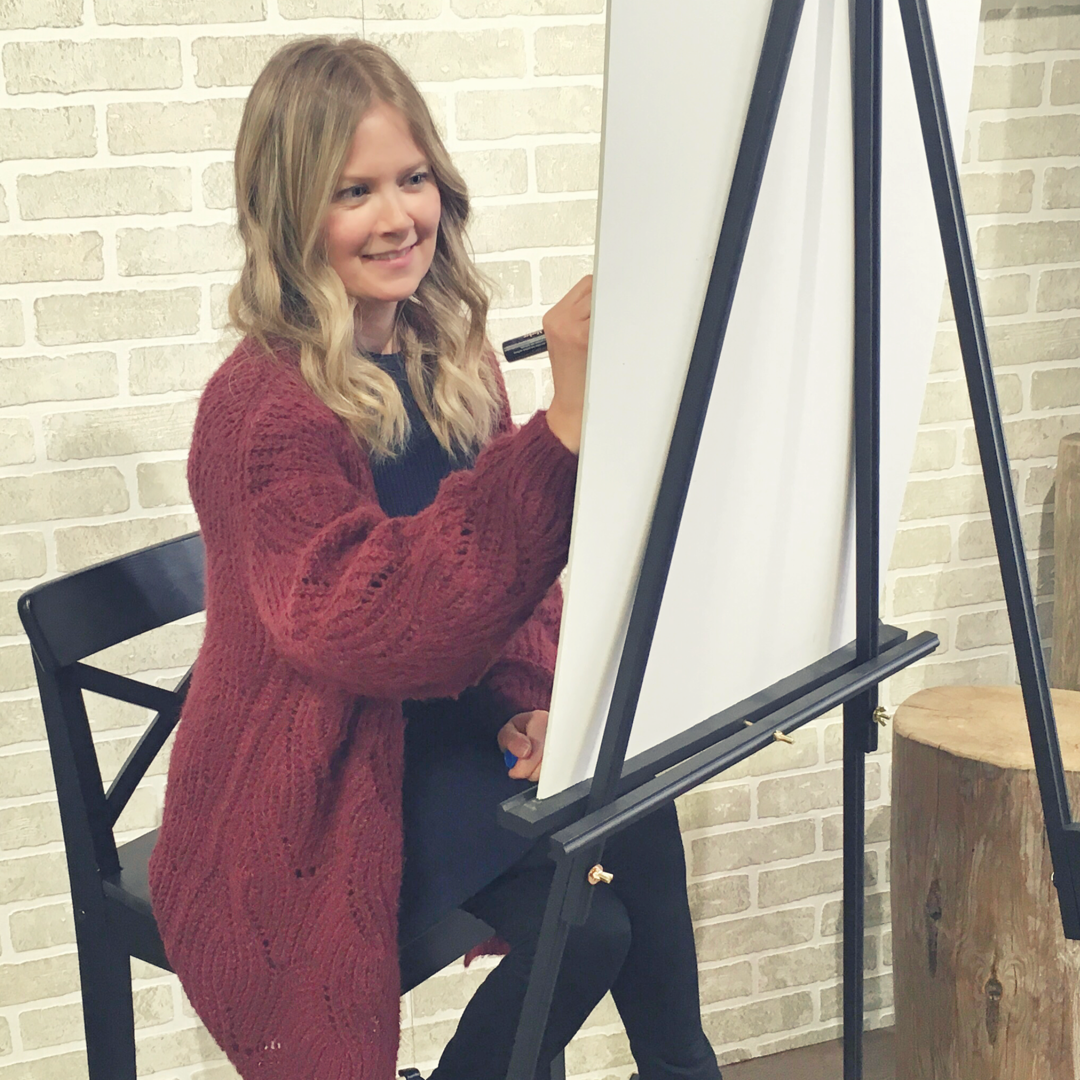 Tanya painting at easel off location