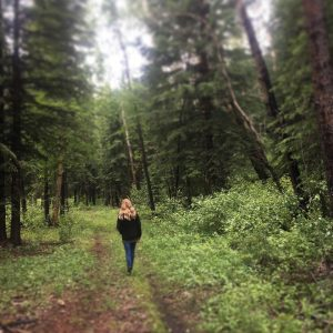 Tanya walking in the forest